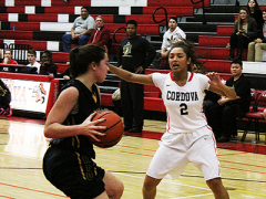 Cordova guard Nikki Jones gets into the face of a Rio Americano player during a recent non-conference home game. Jones and the Lady Lancers remain undefeated in SVC action.  --Photo by Mike Bush