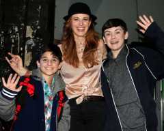 "Backstage in Broadway's Lunt-Fontanne Theater, Teal Wicks poses with ""Finding Neverland"" juvenile stars Casey Butler and Christian Camporin."