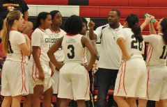 Cordova girls basketball coach Raymond Bradley, right, talks with his players during last Thursday's home game against Liberty Ranch. The Lady Lancers are tied for first place in the Sierra Valley Conference. Photo by Rick Sloan