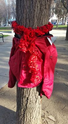 All For You Home Care wrapped the jackets and scarves around the tree trunks and lined the pockets with gloves, mittens, and hats — leaving them for anyone in need. Photo courtesy All For You Home Care