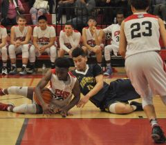 Cordova guard Damion Baldwin battles for a loose ball with a Rosemont player during a recent SVC game. Baldwin and the Lancers are 6-1 in conference action. Photo by Rick Sloan