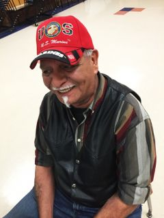 """U.S. Marine Corps veteran Daniel Gomez served four tours in Vietnam. Twice-wounded, he contracted malaria and was exposed to the chemical defoliant Agent Orange. When asked why he was attending the writing workshop, he said, """"To figure out why the hell I'm still here."""""""