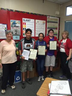 "Left to right: American Legion Auxiliary member and unit historian Virginia Hicks; Nicholas Pertl displays his first place essay and the awards he won for his prize-winning essay on the theme, ""What Can I Do for My Country?""; Yukari Ide, third place winner; Rodrigo Cabrales, second place winner; and Elise Spleiss, ALA Americanism chair. Photo courtesy Deborah House"