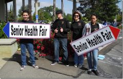 Students hold signs to help promote SOAR's annual health fair. Photo courtesy SOAR