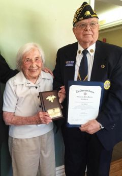 Balmer holds a plaque recognizing her as the oldest living female member of the American Legion.  Her nephew, Ken Hicks holds her certificate of lifetime membership. 