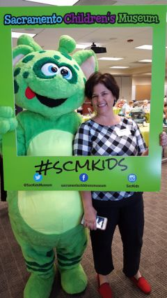 Sharon Stone Smith executive director of the Sacramento Children's Museum (right), with Leo, museum mascot.