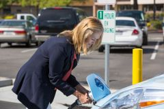 SMUD Director Renée Taylor attaches a Nissan Leaf to the new SMUD electric vehicle fast charger at 7825 Lichen Drive in Citrus Heights, just off of Interstate 80. This new station can charge most EVs in less than 30 minutes. 
