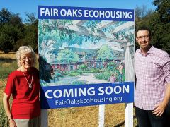 Marty Maskall (left), Project Manager, and Brandon Rose, ECOS president, stand next to a perspective sketch at the site of the future Fair Oaks EcoHousing site, their future residence.