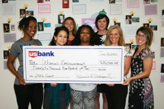 Students and staff at Women's Empowerment accept a check from U.S. Bank Foundation representatives Jessica Cook and Pam Maxwell.