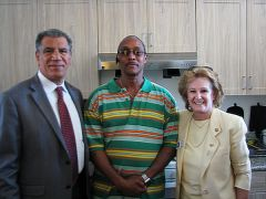 Juan, one of the residents at Veteran's Village, proudly invited attendees to view his apartment so they could see the new lifestyle of formerly homeless veterans benefitting from the new complex. With Juan are Cyrus Abhar, City Manager and Linda Budge, City Councilwoman.