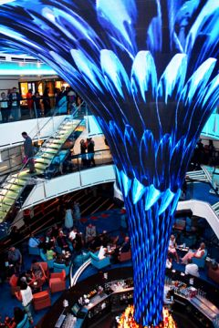 Disconcerting as it was to walk onto a Carnival ship and not be awestruck by towering glass elevators, the three-story, vortex-shaped DreamScape is a grand replacement of the atrium's signature piece. The HD LED tube changes graphics several times during a cruise, and is just gorgeous.