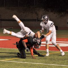Cordova defensive back Raymond Flite trips up a Vista del Lago player. 