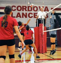 Cordova volleyball player Shaieve Clore sends the ball over the net during a recent home match. Watching are teammates Gianna Bell (10) and Yesfir Oliferchik (4). 