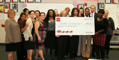 Women's Empowerment staff and students accept a check from Wells Fargo representatives for job training for formerly homeless women.