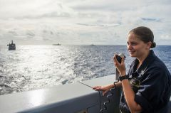 Ensign Janice Mallery, from Roseville, Calif., acts as conning officer as the amphibious transport dock ship USS Green Bay (LPD 20) get into formation with ships from Carrier Strike Group 5 and Expeditionary Strike Group 7 to participate in a photo exercise to signify the completion of Valiant Shield 2016. Valiant Shield 2016 is a biennial, U.S.-only, field training exercise (FTX) with a focus on integration of joint training among U.S. forces. Green Bay, part of the Bonhomme Richard Expeditionary Strike Group with embarked 31st Marine Expeditionary Unit, is participating in Valiant Shield in an effort to increase naval integration and joint capabilities in the event of conflict, contingency, or disaster relief. 