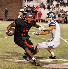 Cordova quarterback Xavier Johnson, shown here running for yards against Vista del Lago last month, and the Lancers celebrate homecoming and open Sierra Valley Conference action against Galt at Lancers Stadium tonight.  --Photo by Rick Sloan