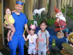 "The week after Halloween, dentist Jose Juarez will be buying back Halloween candy and donating it to U.S. troops through Operation Gratitude. He is shown here in the ""enchanted forest"" with three of his four daughters: Yesenia, (right), Vida and Marlena. Oldest daughter Adeliana, was at school at the time of the photo."