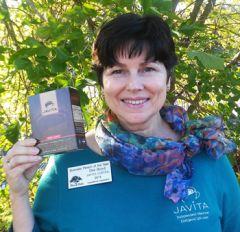 Dot Boyd, Javita Distributor, Bella Vista HS Graduate, Fair Oaks Chamber Ambassador holding a box of Javita Coffee.