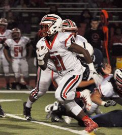 Cordova running back Deante McCullough, seen here rushing against Rosemont in the SVC finale last month, was named to the all-SVC first team.  --Photo by Rick Sloan