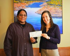 Loren Nakai of Sierra Native Alliance receives his check from Eileen Speaker, Grants Manager at Placer Community Foundation.
