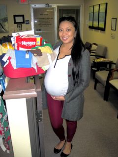 A Sacramento Life Center client receives a baby basket shortly before giving birth. The center is running its annual Baby Basket Drive through December.