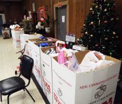 Some of the 18 boxes of toys, games and other items donated to prior drop-off events. 