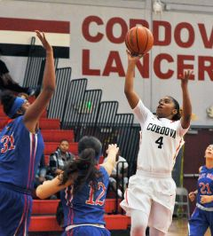 Taking the shot in a recent game is Cordova guard Amia Moore (4).  --Photo by Rick Sloan