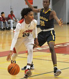 Cordova guard Markell Briggs drives around an Inderkum player in last week's Cordova Christmas Classic. The Lancers took third place in their own tournament.  --Photo by Rick Sloan
