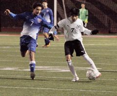 In the battle of players wearing No. 7, Cordova defender Oscar Natalio (right) battles a Christian Brothers' player in last week's non-league game at Lancers Stadium.  --Photo by Rick Sloan