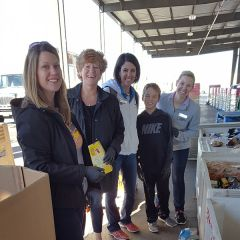 Volunteers from California Connections Academy @ Ripon sort food in their service project at the Sacramento Food Bank.