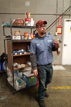 Jason Meadows, warehouse coordinator for the Sacramento Food Bank, demonstrates methods and procedures to volunteers from California Connections Academy @ Ripon.