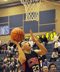 Cordova guard Mike Brown eyes the basket during an SVC game at Rosemont recently. Brown was one of four Lancers who scored in double digits against Galt in Tuesday's conference home game.  --Photo by Rick Sloan