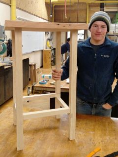Nathan Barton, recipient of the John G. and Lillian M. Walsh Family Scholarship, shown with the table he made at Sierra College.