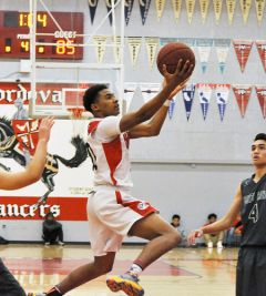 Cordova guard Calvin Augusta, shown here during a recent SVC game, and the Lancers' boys basketball team opened the Sac-Joaquin Section Division III playoffs at Capital Christian on Wednesday.  --Photo by Rick Sloan