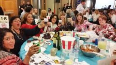 Employees & friends of Hot Dog on a Stick toast their good time at the Rotary crab feed at the Citrus Heights Community Center on February 11.