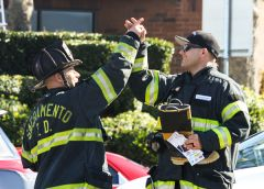 Firefighters celebrate as this year's drive for burn victims raises a record $149,000. 