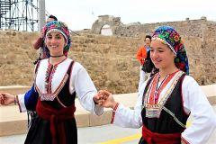 Dancers welcome cruisers at the port of Rhodes. 