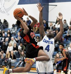 Cordova guard Calvin Augusta drives the lane past a Capital Christian player in the Sac-Joaquin Section Division III playoff opener last week.  --Photo by Rick Sloan