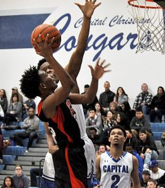 Cordova guard Markell Briggs takes the shot against Capital Christian in last week's playoff game.  --Photo by Rick Sloan