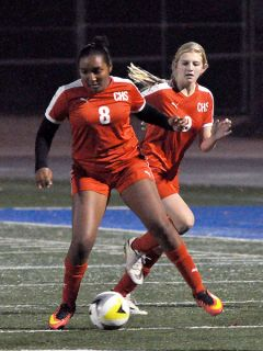 Cordova soccer players Kelsie Graf (8) and Shelby Konarshi (9), seen here in a home game against Capital Christian earlier this season, helped the Lancers to a third place finish in the SVC and a Sac-Joaquin Section Division III playoff berth.  --Photo by Rick Sloan