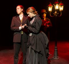 Dr. Jekyll (Davyd Glubochanskyy) tries to avoid the inescapable truth from Elizabeth Jelkes (Emily Masnica) as his alter self, Mr. Hyde (Joshua Byfield) lurks in the background.  --Photo by Daryl Stinchfield
