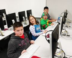 From left to right, Skycrest Elementary students Kevin Martinez, Clarissa Viers, Marcelo Cruz and Raonak Bajracharya have some fun in the computer lab on the first day of Playmakers.