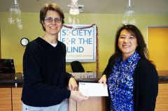 Shari Roeseler of Society for the Blind and Tisha Mora of US Bank. 