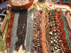 Beautiful, polished stones have been strung by hand in a variety colors and sizes to create one of a kind necklaces for sale during the Gem Show. 
