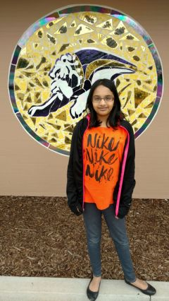 Samhita Kumar, a sixth grader at Winston Churchill Middle School, stands in front of a mosaic of the school's mascot. She is the 2017 California Central Valley Spelling Bee champion and will head to the Scripps National Spelling Bee in Washington, D.C. in May.