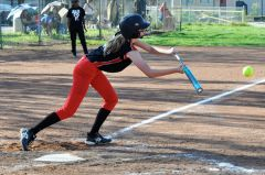 Cordova softball player Alexis Wygand puts down a bunt against Galt in an SVC game on the Lancers' field on Tuesday. Wygand is one of two fresh-men on the varsity squad this season. 