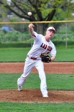 Cordova baseball player Austin Smith throws a pitch during a recent home game against Rosemont. Smith and the Lancers are 2-1 in the SVC.  --Photo by Rick Sloan