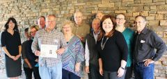 Photo caption: Keith Hentschel, pictured below with the Board and Staff of Seniors First is presented a certificate acknowledging a $5,000 gift to the Seniors First Endowment Fund Placer Community Foundation.