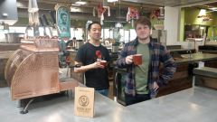 Jesse Song left, and shift supervisor, Alex Murio enjoy an afternoon brew at Insight Coffee Roasters' newest location in Milagro Center.