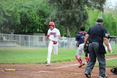 Cordova's Ryan Tipton races toward home plate against Redwood Christian in a pool play game on April 11th . Tipton and the Cordova baseball team resumed SVC action on Wednesday.  -- Photo by Mike Bush